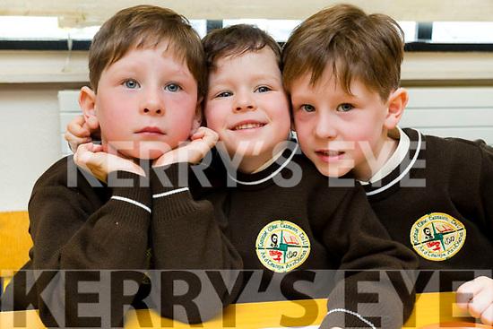 Triplets Conchúr Ó Muineacháin, Sean Ó Muineacháin agus Tomás Ó Muineachain, pictured on their first day of school at Gaelscoil Mhic Easmainn, Tralee, on Wednesday morning last.