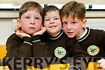 Triplets Conchúr Ó Muineacháin, Sean Ó Muineacháin agus Tomás Ó Muineachain, pictured on their first day of school at Gaelscoil Mhic Easmainn, Tralee, on Wednesday morning last.