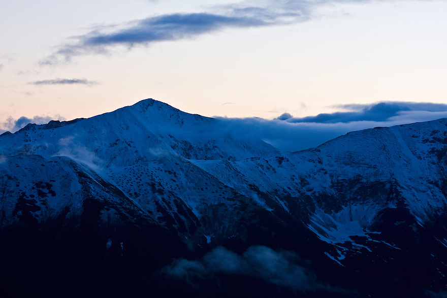 Sunset clouds and snow and Mount Bystrà (2248m asl). Western Tatras, Slovakia. June 2009. Mission: Ticha