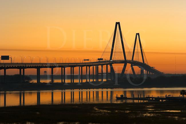 Ravenal Bridge over the Cooper River in orange sunrise, Charleston, South Carolina, SC, USA. Longest cable suspension bridge in the western hemisphere.