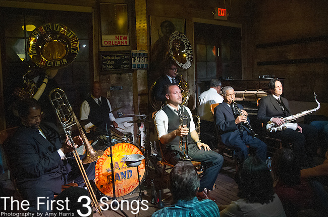 Freddie Lonzo, Joe Lastie Jr., Clint Maedgen, Rickie Monie, Mark Braud, Ronell Johnson, Charlie Gabriel, and Ben Jaffe of the Preservation Hall Jazz Band perform at Preservation Hall in New Orleans, LA.