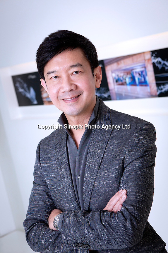 Hong Kong businessman Dickson Poon poses in his offices in Hong Kong 14th September 2011. Poon is involved in the luxury retain industry with large interests in Harvey Nichols and S.T. Dupont.<br /> <br />  Credit photo by Tim O'Rourke  / SINOPIX