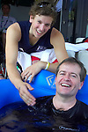 Australian wheelchair basketball team member, Dylan Alcott cheers the Federal Minister (Disabilities and Children's Services)Mr Bill Shorten on as he takes up a challenge from the Australian Men's Wheelchair basketball team to take an ice bath with them.15 September, 2008.