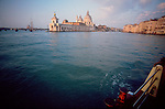 Venice, Italy, A vaporetta entering the Grans Canal with the Basilica della Salute on the left bank, Europe,.