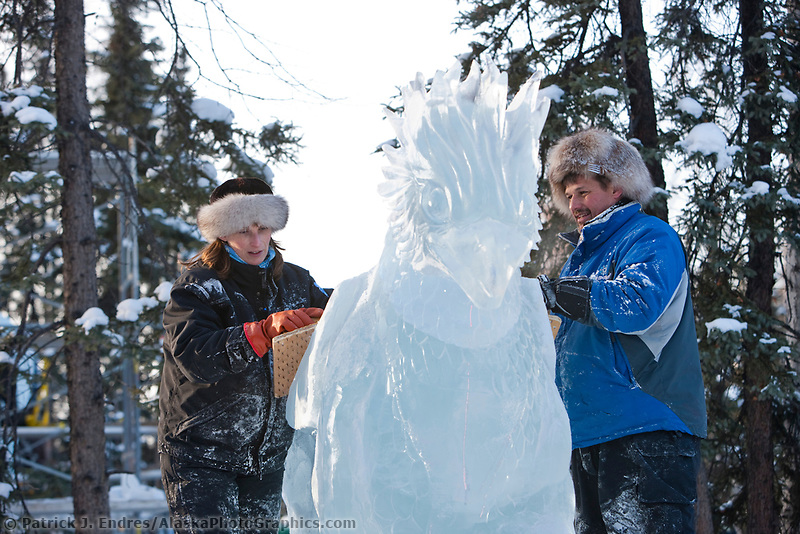 "Jeff Stahl and Heather Brice, USA, work on the multi block sculpture titled ""Guardian Angel of Mischief"" for the 2009 World Ice Art Championships in Fairbanks, Alaska. Team members: Heather Brice, Kevin Gregory, Jeff Stahl, Steve Cox"