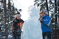 """Jeff Stahl and Heather Brice, USA, work on the multi block sculpture titled """"Guardian Angel of Mischief"""" for the 2009 World Ice Art Championships in Fairbanks, Alaska. Team members: Heather Brice, Kevin Gregory, Jeff Stahl, Steve Cox"""
