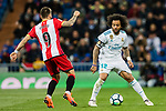 Marcelo Vieira Da Silva of Real Madrid (R) fights for the ball with Cristian Portugues Manzanera, Portu, of Girona FC (L) during the La Liga 2017-18 match between Real Madrid and Girona FC at Estadio Santiago Bernabéu  on March 18 2018 in Madrid, Spain. Photo by Diego Souto / Power Sport Images