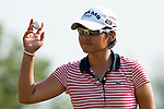 CHON BURI, THAILAND - FEBRUARY 20:  Yani Tseng of Taiwan acknowledges to the crowd on the 17th green during day four of the LPGA Thailand at Siam Country Club on February 20, 2011 in Chon Buri, Thailand.  Photo by Victor Fraile / The Power of Sport Images
