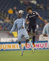 Sporting Kansas City midfielder C.J. Sapong (17) and New England Revolution defender Kevin Alston (30) battle for head ball. In a Major League Soccer (MLS) match, the New England Revolution defeated Sporting Kansas City, 3-2, at Gillette Stadium on April 23, 2011.
