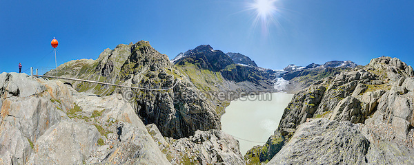Switzerland, Western Europe, Berner Oberland, nr. Innertkirchen and Gadmen. Trift lake, Trift glacier and the Trift swing bridge with a 170 meter range. Note: This is a digitally stitched panoramic image. No releases available.