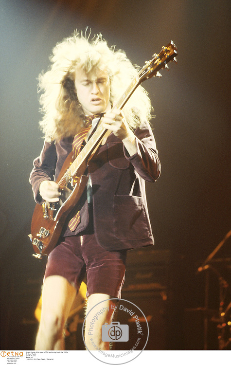 Angus Young of the band AC/DC performing live in the 1980's<br />