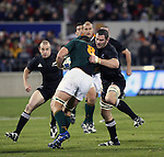 All Black Reuben Thorne wraps up Springbok No 8 Jacques Cronje while Brendon Leonard supports during the international rugby match between the New Zealand All Blacks and South Africa at Jade Stadium, Christchurch, New Zealand. 14 July 2007. Photo: Marc Weakley