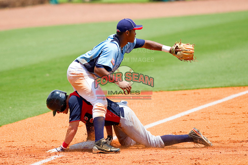 Spencer Edwards #3 of AABC slides into third base as Addison Russell #21 of Dixie waits for the throw at the 2011 Tournament of Stars at the USA Baseball National Training Center on June 25, 2011 in Cary, North Carolina.  The AABC defeated Dixie 4-2.  (Brian Westerholt/Four Seam Images)