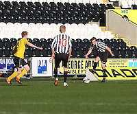 Kieran Doran plays the ball forward to Jack Smith (10) as Liam Dick closes down in the St Mirren v Falkirk Clydesdale Bank Scottish Premier League Under 20 match played at St Mirren Park, Paisley on 30.4.13.