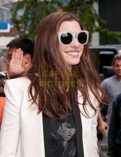 "Anne Hathaway.""The Daily Show"" Arrivals, New York City, NY USA..August 18t, 2011.half length black top white jacket blazer sunglasses shades elvis presley print.CAP/ADM/CS.©Christopher Smith/AdMedia/Capital Pictures."