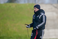 SWANSEA, WALES - JANUARY 28:  Garry Monk, Manager of Swansea City watches his players during trainingon January 28, 2015 in Swansea, Wales.