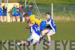 Ballymac's Matthew Galvin gets caught by Templenoe's Teddy Doyle and Denis O'Neill in the division 3 clash at Ballymac on Saturday.