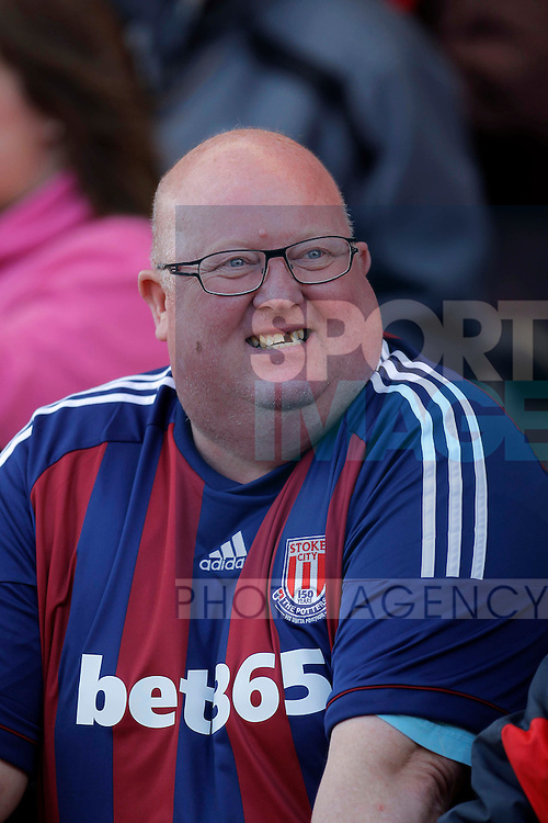 A happy supporter of Stoke City..Barclays Premier League match between Stoke City v Bolton Wanderers at the Britannia Stadium, Stoke on the 13th May 2012. Pic Malcolm Couzens/SPORTIMAGE...