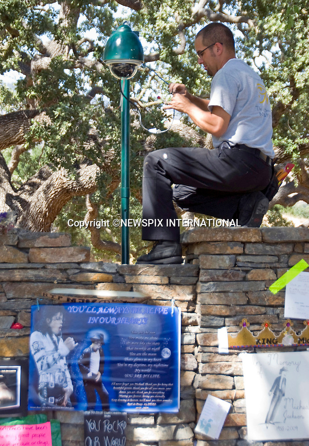 """MICHAEL JACKSON_Neverland Increased Security.Security being stepped up at The Neverland Ranch, prior to Michael Jackson's Farewell. Workmen placed new security cameras around the perimeter of the Estate, Los Olivos, California_06/07/2009.Mandatory Photo Credit: ©Dias/Newspix International..**ALL FEES PAYABLE TO: """"NEWSPIX INTERNATIONAL""""**..PHOTO CREDIT MANDATORY!!: NEWSPIX INTERNATIONAL(Failure to credit will incur a surcharge of 100% of reproduction fees)..IMMEDIATE CONFIRMATION OF USAGE REQUIRED:.Newspix International, 31 Chinnery Hill, Bishop's Stortford, ENGLAND CM23 3PS.Tel:+441279 324672  ; Fax: +441279656877.Mobile:  0777568 1153.e-mail: info@newspixinternational.co.uk"""
