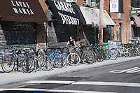Many bikes are parked at the corner of Bedford Avenue in the Williamsburg neighborhood of the New York City borough of Brooklyn, NY, Monday August 1, 2011. Williamsburg is an influential hub for hipster culture