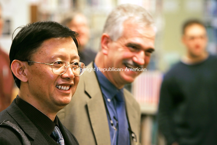 WOODBURY, CT -17 January 2005 -011706JS02---Sun Zhuwen, principal of No. 1 High School of Wulian in Shandong Province of China, left, is introduced by John Vecchitto, pricipal of Nonnewaug High School in Woodbury during a reception in the media center/library of the school on Tuesday.  Sun Zhuwen was at the school as part of an international educational program  --- Jim Shannon Republican-American -- Sun Zhuwen; No. 1 High School of Wulian in Shandong Province of China, John Vecchitto, Nonnewaug High School, Woodbury are CQ
