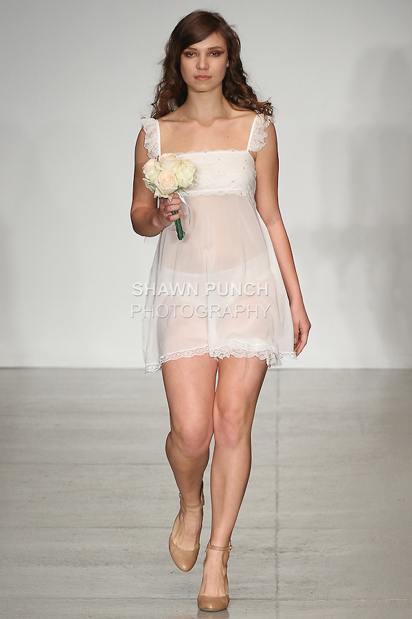 Model walks runway in lingerie from The Giving Bride Spring Summer 2015 collection by Maggie Gillette, for the Made in NYC lingerie fashion show, during LingerieFW Spring Summer 2015.
