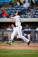 West Michigan Whitecaps third baseman Josh Lester (32) follows through on a swing during a game against the Clinton LumberKings on May 3, 2017 at Fifth Third Ballpark in Comstock Park, Michigan.  West Michigan defeated Clinton 3-2.  (Mike Janes/Four Seam Images)