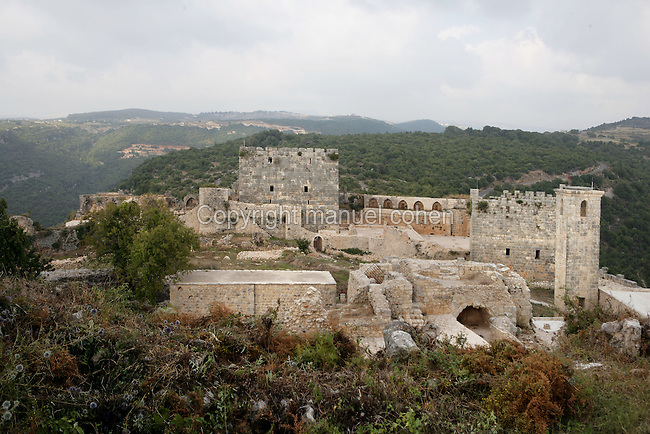 Courtyards with ruined Byzantine Citadel and 2 Crusaders bastion towers, Castle of Saladin, 10th-12th century, Latakia, Syria. In 1188 Saladin succeeded in occupying it and it stayed in Muslim hands from Saladin to Baibars to Qalaun.