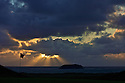 View of the sun setting and incoming storm on the 13th Green of the Glashedy Links course, Ballyliffin GC, Inishowen, Co.Donegal, Ireland.© PHIL INGLIS