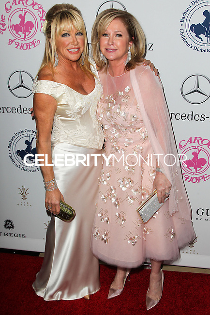BEVERLY HILLS, CA, USA - OCTOBER 11: Suzanne Somers, Kathy Hilton arrive at the 2014 Carousel Of Hope Ball held at the Beverly Hilton Hotel on October 11, 2014 in Beverly Hills, California, United States. (Photo by Celebrity Monitor)