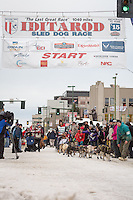 leave the ceremonial start line with an Iditarider at 4th Avenue and D street in downtown Anchorage, Alaska during the 2015 Iditarod race. Photo by Jim Kohl/IditarodPhotos.com