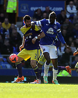 Pictured L-R: Jordi Amat challenged by Lacina Traore of Everton. Sunday 16 February 2014<br />
