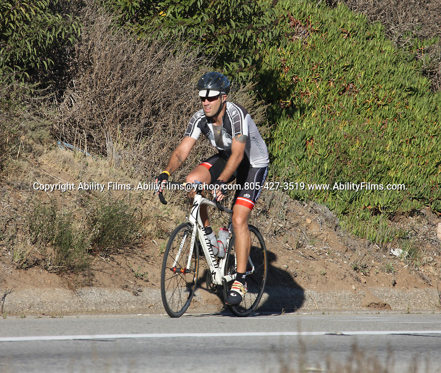 ....OCTOBER 13TH 2011   Exclusive ..Carson Daly riding his bicycle down Pacific Coast Highway in Malibu California ..AbiliyFilms@yahoo.com.805-427-3519.www.AbilityFilms.com.