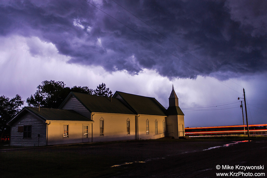 Church at Night under a Purple Thunderstom Cloud backlit by Lightning near Chapman, KS