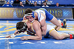 BROOKINGS, SD - JANUARY 18: Martin Mueller from South Dakota State University has control of Chaz Polson from Wyoming during their 184 pound match Thursday night at Frost Arena in Brookings. (Photo by Dave Eggen/Inertia)