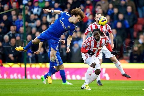 12.01.2013.  Stoke, England. Chelsea defender David Luiz wins the header from Stoke City forward Kenwyne Jones during the Premier League game between Stoke City and Chelsea from the Britannia Stadium, Stoke.