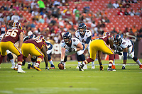 Landover, MD - August 24, 2018: Denver Broncos quarterback Case Keenum (4) lines up under Denver Broncos center Matt Paradis (61) during preseason game between the Denver Broncos and Washington Redskins at FedEx Field in Landover, MD. The Broncos defeat the Redskins 29-17. (Photo by Phillip Peters/Media Images International)