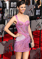 LOS ANGELES, CA, USA - APRIL 13: Actress Victoria Justice wearing Atelier Versace dress, Brian Atwood shoes, Edie Parker clutch, and Kami Lerner and ELAHN jewels arrives at the 2014 MTV Movie Awards held at Nokia Theatre L.A. Live on April 13, 2014 in Los Angeles, California, United States. (Photo by Xavier Collin/Celebrity Monitor)