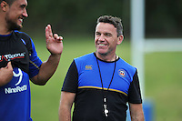 Bath Rugby Head Coach Mike Ford is all smiles after the session. Bath Rugby training session on August 4, 2015 at Farleigh House in Bath, England. Photo by: Patrick Khachfe / Onside Images