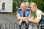Sargeant Dermot O'Connell, Killarney Gardaí pictured with Karina McCarthy, Ring of Kerry charity cycle committee, as they remided cyclists to make sure they stayed safe on the charity cycle on Saturday. .. ...........................................