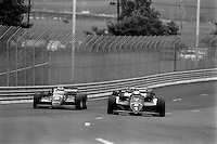 EAST RUTHERFORD, NJ - JUNE 30: Mario Andretti (#1) drives his  Lola T900/Cosworth ahead of Bobby Rahal (#3) in a March 85C/Cosworth during the Meadowlands U.S. Grand Prix CART IndyCar race at the Meadowlands Sports Complex in East Rutherford, New Jersey, on June 30, 1985.