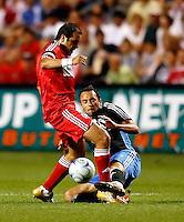 San Jose midfielder Ramiro Corrales (12) knocks the ball away from Chicago Fire midfielder Cuauhtemoc Blanco (10).  The Chicago Fire tied the San Jose Earthquakes 0-0 at Toyota Park in Bridgeview, IL on June 28, 2008.