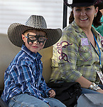 Six-year-old Owen, from Washoe Valley, disguised as Batman during the Reno Rodeo on Saturday, June 20, 2015.