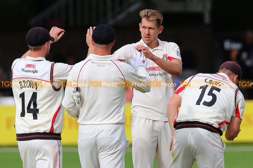 Tom Bailey of Lancashire (2nd R) is congratulated by his team mates after taking the wicket of Jesse Ryder during Essex CCC vs Lancashire CCC, Day Two