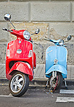 Parent and child. Two Vespas on the street in Naples Italy.