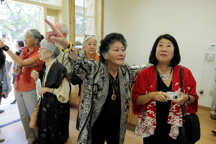 Relatives of the Jingu family look at photo prints hanging on the wall during the grand re-opening of the Jingu House, Saturday, Oct. 22, 2011, at the Japanese Tea Garden in San Antonio, Texas, USA. (Darren Abate/pressphotointl.com)