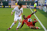 Luis Moreno (3) of Panama plays the ball as Heath Pearce (2) of the United States (USA) watches. The United States (USA) defeated Panama (PAN) 2-1 during a quarterfinal match of the CONCACAF Gold Cup at Lincoln Financial Field in Philadelphia, PA, on July 18, 2009.