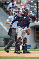Gwinnett Braves catcher Christian Bethancourt (38) gets a new baseball from home plate umpire Derek Mollica during the game against the Charlotte Knights at BB&T BallPark on July 3, 2015 in Charlotte, North Carolina.  The Braves defeated the Knights 11-4 in game one of a day-night double header.  (Brian Westerholt/Four Seam Images)