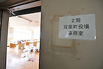 March 30, 2011, Kazo, Japan - Faculty rooms are converted into the town government offices at now- defunct prefectural Kisai High in Kazo in Saitama prefecture, 50 km north of Tokyo, on Wednesday, March 30, 2011. The entire town, neighboring the trouble-stricken Fukushima No.1 nuclear power plant located some 240 km northeast of Tokyo, was relocated to this new location with some 1,200 residents and the government functions. (Photo by AFLO) [3620] -mis-