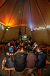 BRUSSELS - BELGIUM -11 December 2018  -- Christmas market in Brussels features a specialty: the Finnish Village. -- Warming up at  the open fire in the Lapland tent. -- PHOTO: Juha ROININEN / EUP-IMAGES